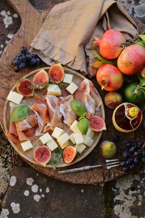italian appetizer antipasti, cheese, ham and fruit