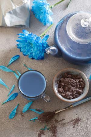 blue masala tea powder on a gray background Stock Photo
