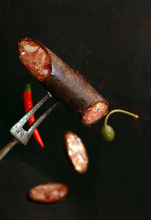 smoked meat sausage with spices and pepper Archivio Fotografico