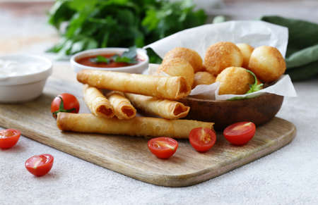 snack fried pies with cheese and sauces Stockfoto