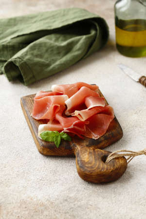 traditional smoked prosciutto ham on a wooden board
