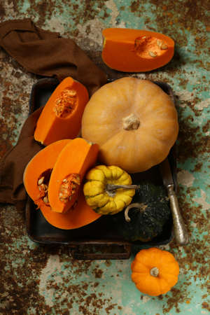 natural organic pumpkins on a rustic table