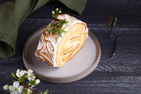 biscuit roll with creamy cream with meringue for dessert