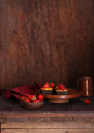 homemade muffins with fresh strawberries on the table Stok Fotoğraf