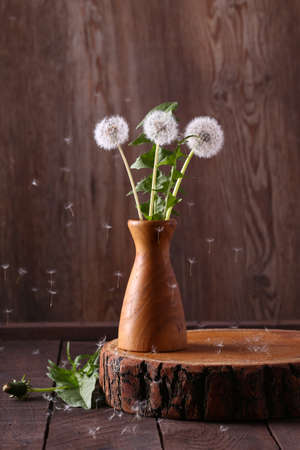 bouquet of wild dandelion flowers on a wooden table Banco de Imagens