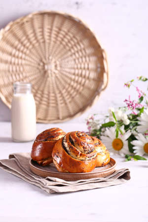 sweet roll poppy seed buns with milk