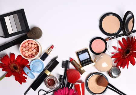 assortment of cosmetics for makeup lipstick powder eye shadow
