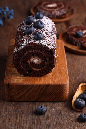 chocolate roll with blueberries for dessert