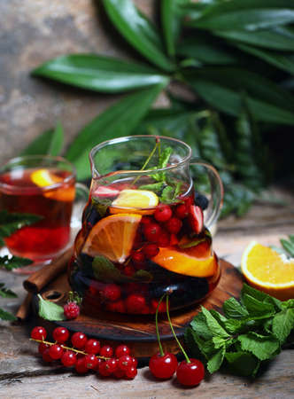 fruit berry tea in a glass teapot
