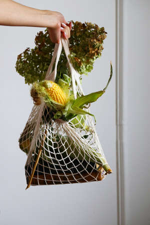 string bag with vegetables and food