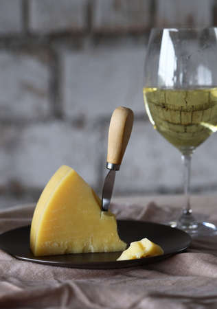 still life white wine glass and cheese