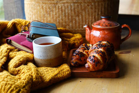autumn still life with croissant and coffee