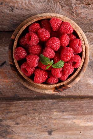 ripe organic raspberries on a wooden table