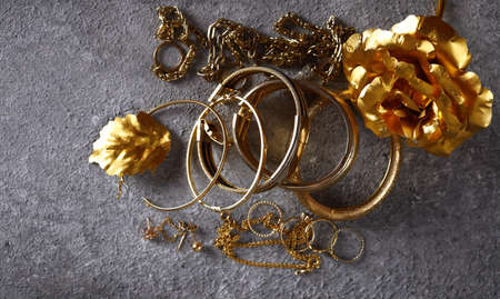 gold jewelry bracelets and chains and rings