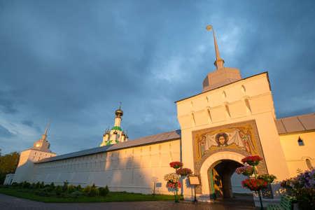 Cross-Exaltation Church In the Tolga convent. Gold ring. Yaroslavl. Russia. Monastery wall illuminated by sunset sunshine