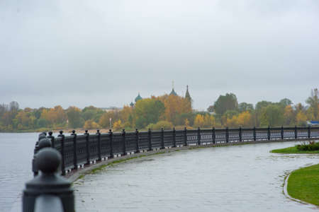 Cast iron fence on the embankment with the prospect of leaving into the distance