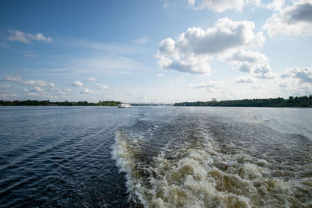 The wave made the boat on the river. A tail of a trace of the riverboat on hydrofoilon a surface of the water on the river.
