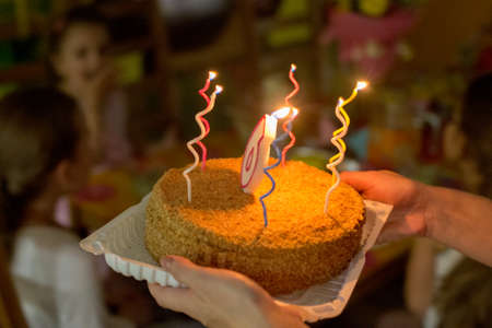 Cake with candles to the birthday of 6 years old, in a cafe Imagens