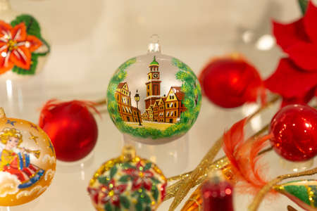 new years Eve ball with a picture of a town and other new years toys Banco de Imagens
