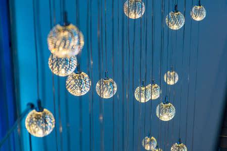 round transparent lamps on long pendant cords Banco de Imagens