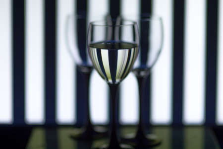 Transparent glasses on a background of black and white stripes