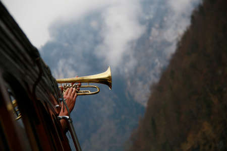 famous trumpet play at lake koenigsee with echo in alps Stock Photo