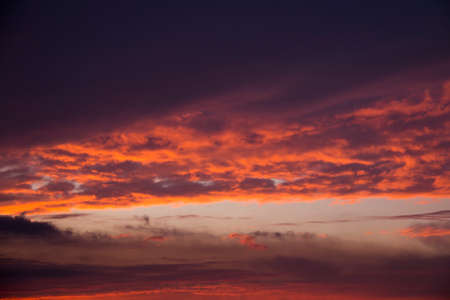 Glowing morning sky with the sun illuminating the sky and clouds Stock Photo