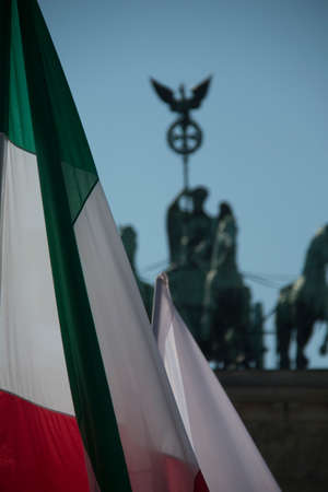 Hungarian or Iranian flag in front of the quadriga at the Brandenburg Gate in Berlin Stock Photo