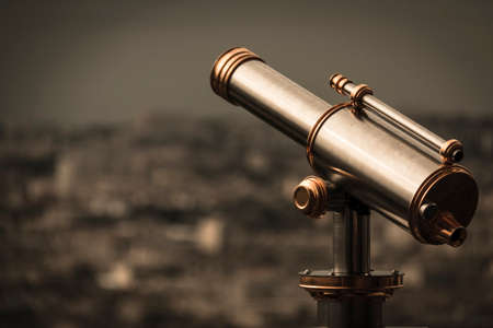 golden and silver vintage binoculars on a platform of eiffel tow