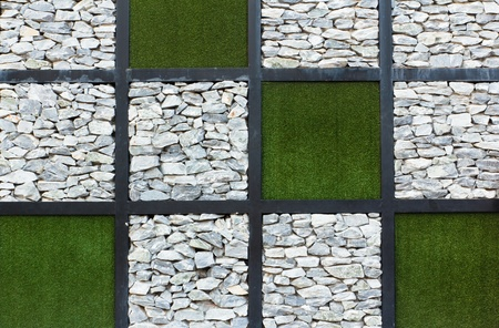 The stones and grass wall abstract background photo
