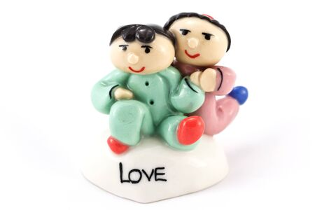The couple ceramic dool on white background  photo