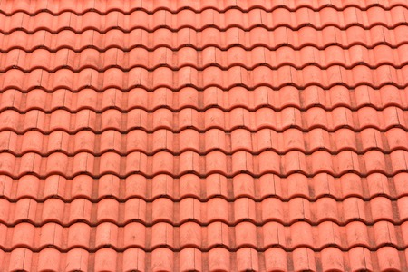 Pattern of the roof with orange tiles  photo