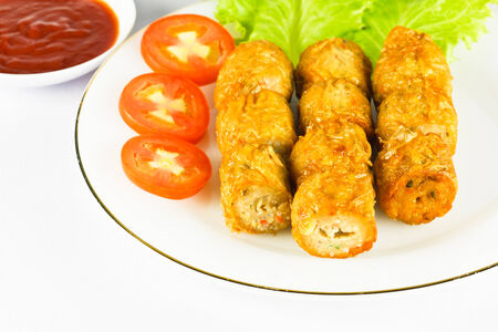 Deep fried chicken roll with tomato,lettuce and sauce  photo