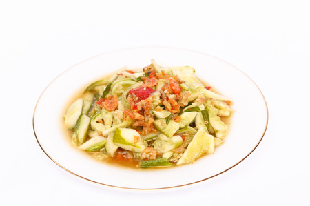 tam: Green cucumber salad on plate.(Som Tam)