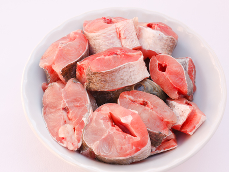 common snakehead: Snake head fish cut into pieces in a bowl. Stock Photo