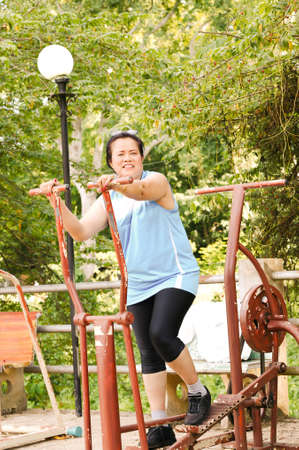 senior woman exercising: Portrait of senior woman exercising in the evening.