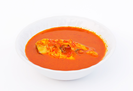 Red curry with Tilapia Fish.Red curry with herbal ingredients,so it is a healthy food that has nutritional value. Stock Photo