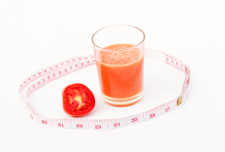 Tomato smoothie  and measure waist,concepts of good vegetables for the good health of the people. Stock Photo