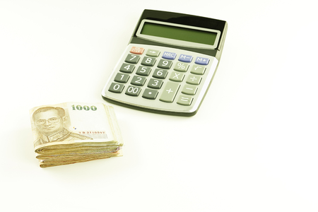 Money saving concept with money and calculator is the essence of presentation.