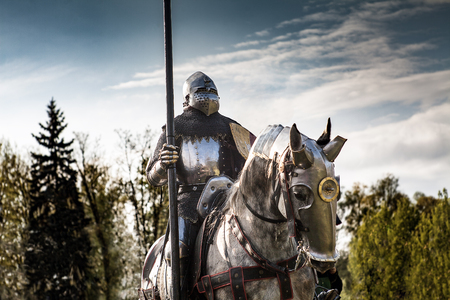Knight on horseback. Horse in armor with knight holding lance. Horses on the medieval battlefield. Editorial