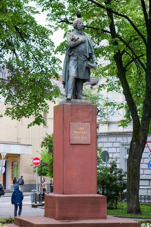 soviet flag: IWANO- FRANKIWSK, UKRAINE - MAY 1, 2017 ; Monument to the poet Adam Mickiewicz near the city center.