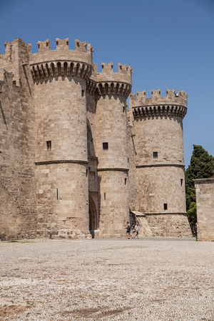 Castle courtyard and three towers. Ruins of the castle and city walls of Rhodes. Defensive Fortress of the Joannites. Historic castle on the shores of the Aegean and Mediterranean.