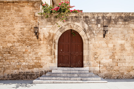Door in the castle courtyard. Ruins of the castle and city walls of Rhodes. Defensive Fortress of the Joannites. Historic castle on the shores of the Aegean and Mediterranean.