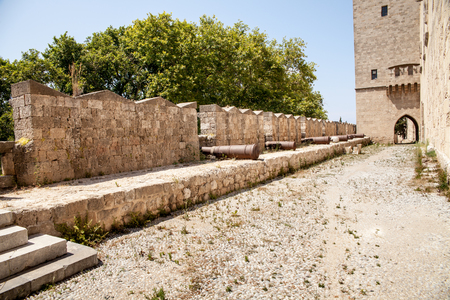 moat wall: Walls with steel cannons. Ruins of the castle and city walls of Rhodes. Defensive Fortress of the Joannites. Editorial