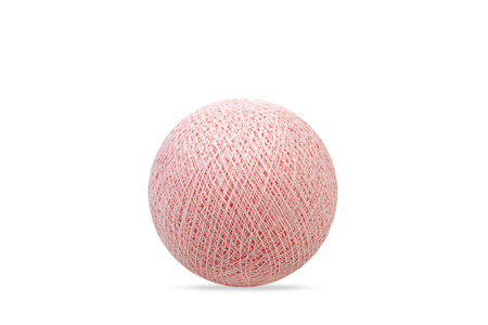 rapprochement: Light pink pastel cotton ball on pure white background.