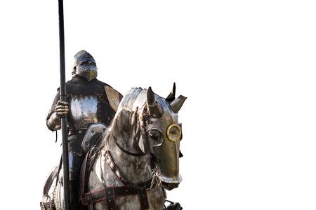 馬に乗った騎士。馬と槍を持った騎士鎧。中世の戦場で馬。 写真素材