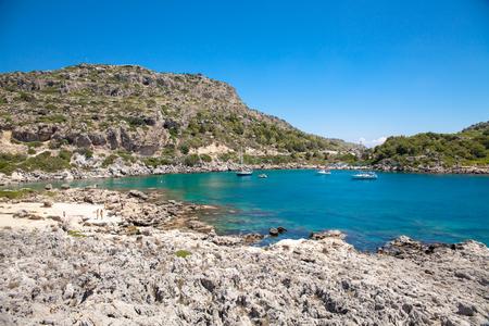 stony coral: Beach off the coast of the island in Greece. Seaside landscape. Rocky coast and sea. Editorial