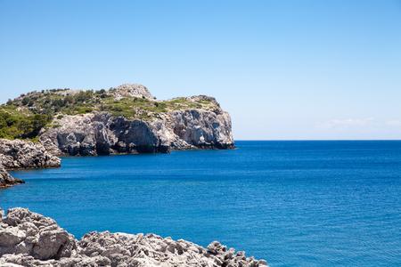 stony coral: Beach off the coast of the island in Faliraki, Greece. Seaside landscape. Rocky coast and sea.