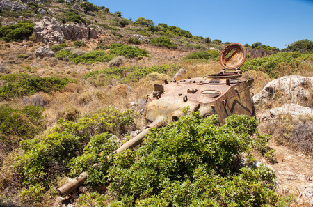 Destroyed tank on the hill. Old upper part of the tank remains after the war in Greece.