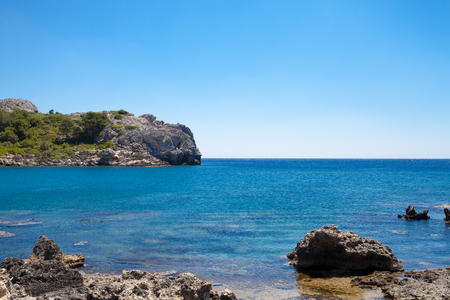 stony coral: Beach off the coast of the island of Rhodes in Greece. Seaside landscape. Rocky coast and sea.